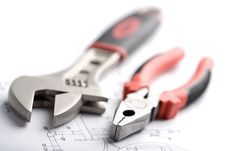 Wrench And Pliers Over Technical Drawing Isolated Royalty Free Stock Photos
