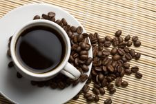 Free White Cup Of Coffee And Coffee Beans Stock Photography - 6789652