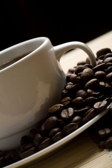 Free White Cup Of Coffee And Coffee Beans Stock Image - 6789671