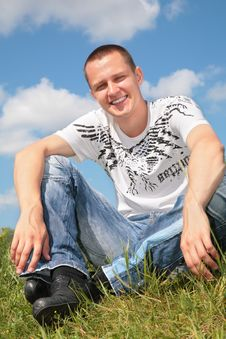 Free Young Man Sits On Grass Royalty Free Stock Photography - 6791497
