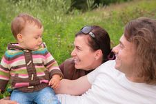 Free Parents With Baby On Nature Stock Image - 6791981