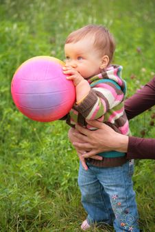 Mother Hold Baby With Ball Royalty Free Stock Image