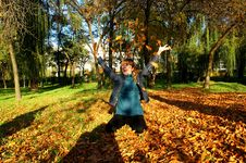 Free Laughing Girl In Autumn Leaves Royalty Free Stock Image - 6792426