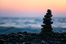 Small Pyramid From Stones On Sunset Seacoast Stock Photo