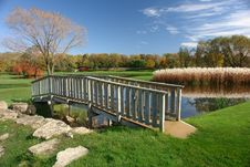 Small Footbridge Over Pond Royalty Free Stock Photos
