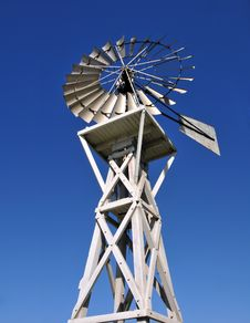 Free Windmill Over Blue Sky Royalty Free Stock Image - 6794636