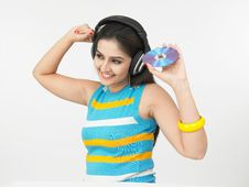 Free Asian Woman Listening To Music Stock Photo - 6794800