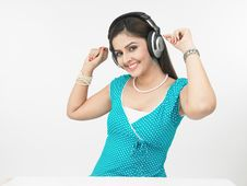 Free Asian Lady Enjoying Music Stock Photos - 6794923