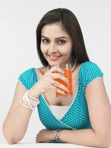 Asian Woman With Orange Juice Stock Photography