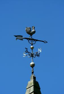 Old Historic Roof With Weather Vane Stock Photo