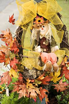 Scarecrow In Wreath Stock Photography