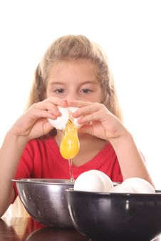 Free Little Girl Cracking An Egg Over Bowl Stock Images - 6798934