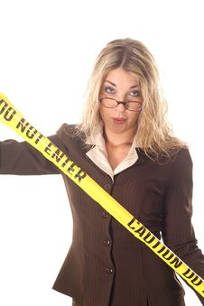 Free Woman With Glasses Holding Do Not Enter Tape Royalty Free Stock Photo - 6799195