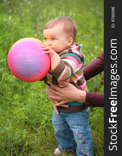 Mother hold baby with ball