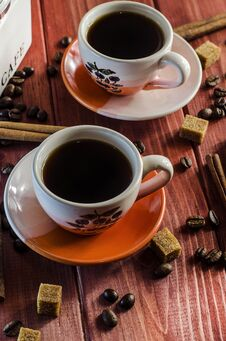 Brewed Coffee And Coffee Beans With Cinnamon Royalty Free Stock Photography