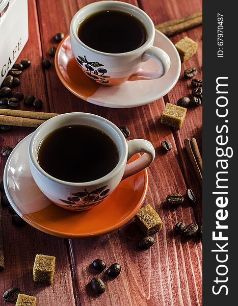 Brewed coffee and coffee beans with cinnamon