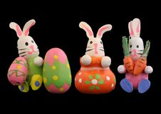 Free Easter Rabbits On Black Backdrop 4 Stock Image - 680421