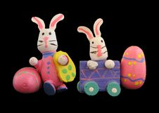 Free Easter Rabbits On Black Backdrop 3 Stock Photography - 680422