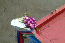 Orchids On A Wooden Fishing Boat Royalty Free Stock Photos