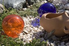 Glass Balls In Garden Rockery. Stock Photos