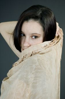 Free Hiding Behind A Beige Scarf Royalty Free Stock Photography - 689367