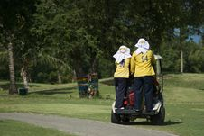 Free Two Caddies On A Golf Cart Stock Image - 6802241