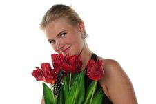Free Woman With Tulips And Revolver Stock Photo - 6802370