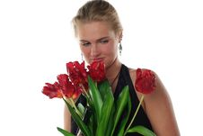 Free Woman With Tulips And Revolver Royalty Free Stock Images - 6802439