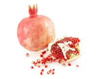 Pomegranate And Scattered Grains. Royalty Free Stock Photography