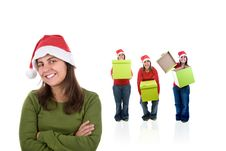 Young Santa Woman With Friends Holding Presents Stock Photos
