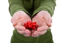 Santa Woman Holding Small Red Ribbon In Her Hands Royalty Free Stock Photo