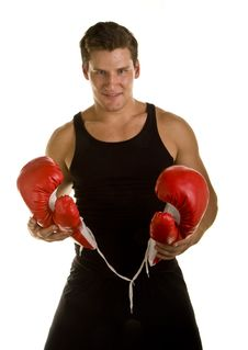 Boxer Holding Gloves And Looking At Camera Royalty Free Stock Images