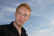 Free Wide-eyed Young Man Against Blue Sky Royalty Free Stock Photo - 6804735