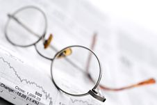 Free Glasses On A Stock Report Royalty Free Stock Image - 6805606