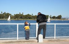 Free Boy And Man Looking At Bay Water Royalty Free Stock Photos - 6807668