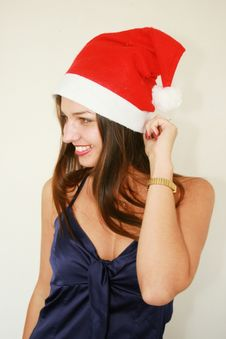 Free Woman Wearing Santa Hat Royalty Free Stock Photography - 6809657