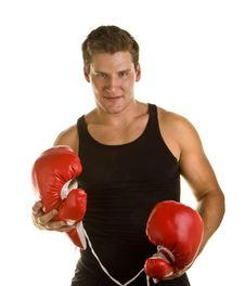 Free Boxer Holding Gloves Stock Image - 6810531