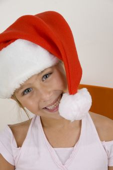 Free Smiling Little Girl Wearing Christmas Hat Stock Images - 6810694
