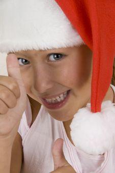 Free Happy Little Girl Wearing Christmas Hat Stock Photo - 6810700