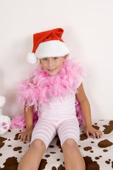 Free Smiling Cute Girl Wearing Christmas Hat Stock Photography - 6810702
