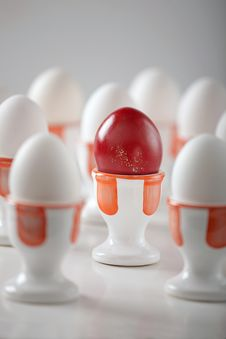 Free Red Egg With Dozen White Eggs Royalty Free Stock Images - 6810759