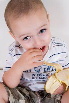 Free Cute Boy Holding Peeled Banana Royalty Free Stock Photo - 6810775
