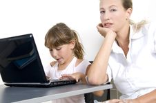 Free Mother And Daughter Working On Laptop Stock Photo - 6810780