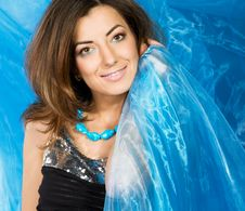 Beautiful Woman With Blue Silk Royalty Free Stock Photography