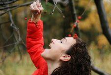 Free Girl Eats A Ashberry (rowan) Royalty Free Stock Photos - 6814248