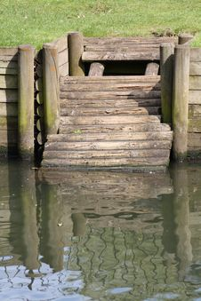 Jetty With Reflection Royalty Free Stock Photos