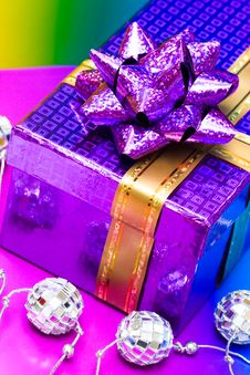Free Gift Box On Violet Royalty Free Stock Photography - 6816137