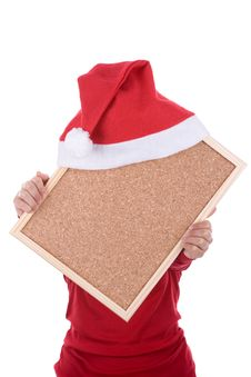 Hand Holding Empty Frame With Red Santa Hat Royalty Free Stock Photos