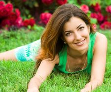 Free Beautiful Woman Lies On Grass Royalty Free Stock Images - 6816589