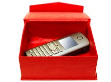 Free Gray Mobile Telephone And Red Cardboard Box. Stock Photos - 6817763